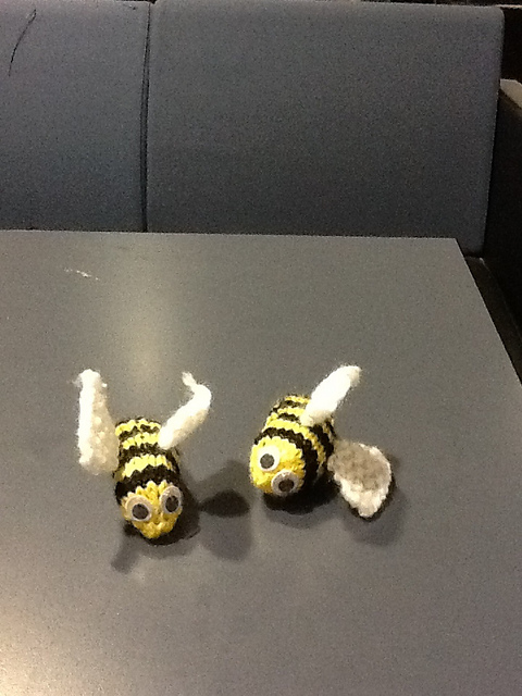 Two little happy bees.