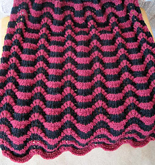 Rippling_waves_blanket_maroon_black_on_table__res_small