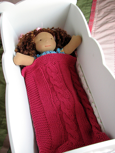 Cable dolls blanket knitted by ravelry member knit4ase