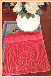 http://www.ravelry.com/patterns/library/seed-stitch-chevron-knit-towel