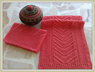 http://www.ravelry.com/patterns/library/eyelet-seed-chevron-reversible-knit-towel